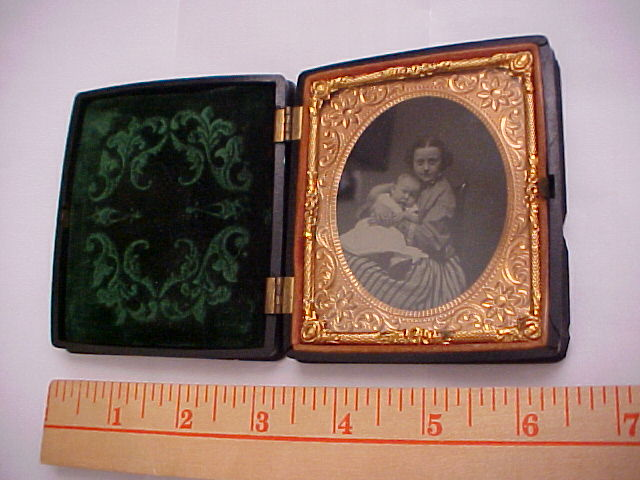 9830 Daguerreotype Girl holding baby    Private Collection.