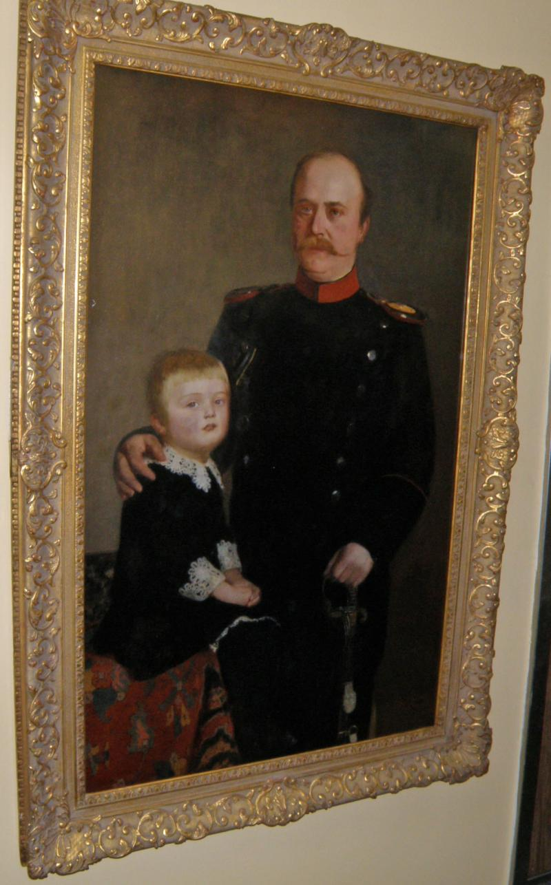 Military Man with a child dated 1884, signed by a British artist